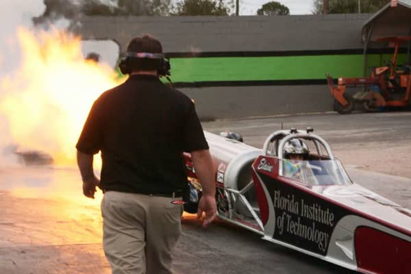 Elaine Larsen, pictured in her vehicle, is the 2014 and 2015 IHRA Jet Dragster World Champion.