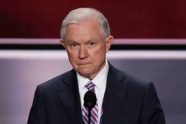 n. Jeff Sessions (R-AL) stands on stage before the start of the first day of the Republican National Convention on July 18, 2016 at the Quicken Loans Arena in Cleveland, Ohio.