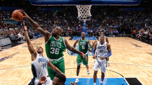 Shaquille O'Neal #36 of the Boston Celtics blocks a shot against Jameer Nelson #14 of the Orlando Magic.