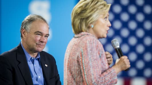 Senator Tim Kaine, a Democrat from Virginia, listens while Hillary Clinton, presumptive 2016 Democratic presidential nominee, speaks during a campaign event at Northern Virginia Community College in Annandale, Virginia.