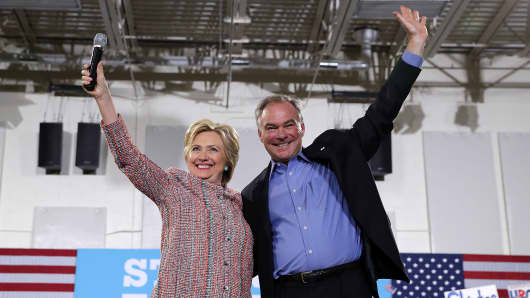 Democratic Presidential candidate Hillary Clinton and US Senator Tim Kaine, Democrat of Virginia, arrive for a campaign rally at Ernst Community Cultural Center in Annandale, Virginia, July 14, 2016.