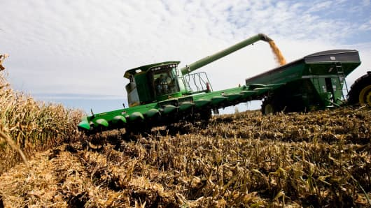 A farmer unloads harvested corn for ethanol production with his John Deere combine harvester in Marshall, Missouri.