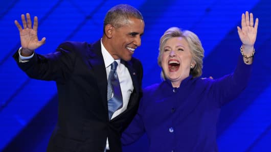 US President Barack Obama stands on stage with Democratic presidential nominee Hillary Clinton on Day 3 of the Democratic National Convention at the Wells Fargo Center, July 27, 2016 in Philadelphia, Pennsylvania.