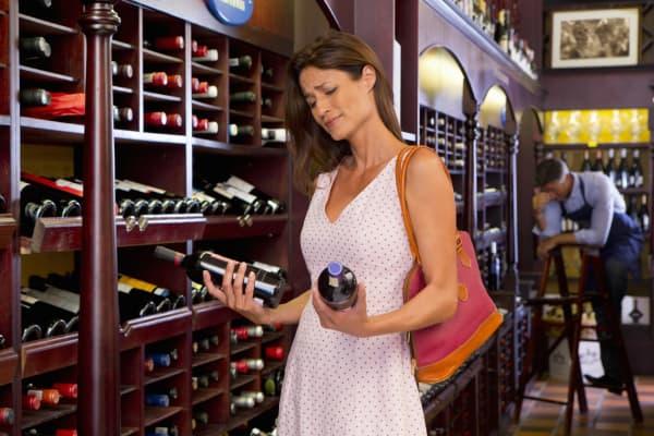 Customer looking at wine bottles
