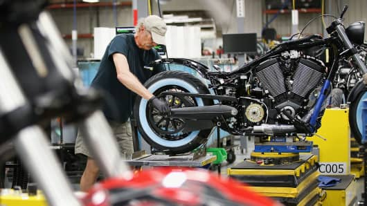 A worker helps to build a Victory motorcycle on the assembly line at the Polaris Industries factory in Spirit Lake, Iowa.