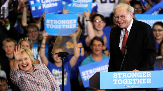 Democratic presidential candidate Hillary Clinton waves to supporters as she is introduced by Warren Buffett during a campaign rally at the Omaha North High Magnet School in Omaha, Nebraska August 1, 2016.