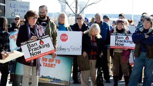 Protesters gather in front of the Thomas McKee Building with signs on November 20, 2014 in Loveland, Colorado.