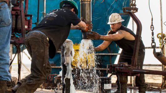Oil workers in the Permian Basin outside Midland, Texas