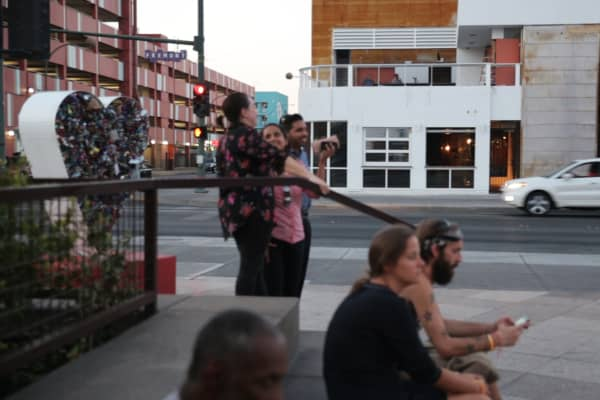 Visitors stand in Container Park across from a construction site where an owner- independent of the Downtown Project- hopes to open a new two-story Indian restaurant.