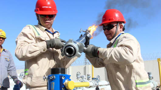 People work at the Halfaya oilfield in Amara, southeast of Baghdad, Iraq.