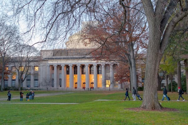 Students walk on the campus of the Massachusetts Institute of Technology.