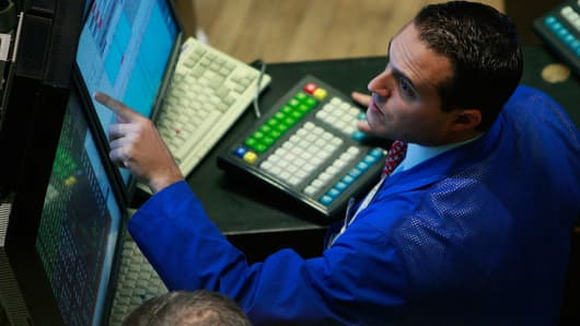 NYSE Trader looking at screen intensely