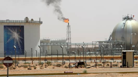 A gas flame is seen in the desert near the Khurais oilfield, near Riyadh, Saudi Arabia.