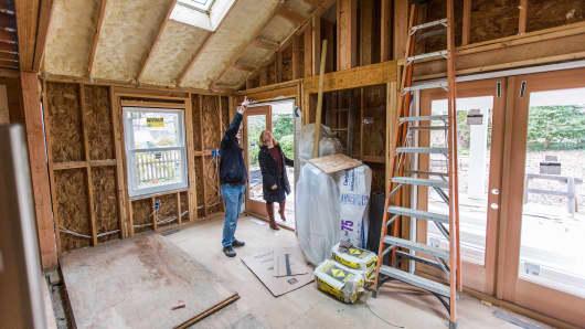 A couple looks over their home renovation progress in Arlington, VA.