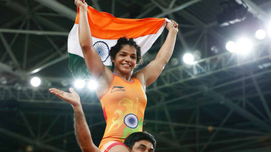 India's Sakshi Malik celebrates after winning against Kirghyzstan's Aisuluu Tynybekova on August 17, 2016, during the wrestling event of the Rio 2016 Olympic Games. Malik won bronze, Russia's Valeria Koblova's took silver and Japan's Kaori Icho obtained gold.