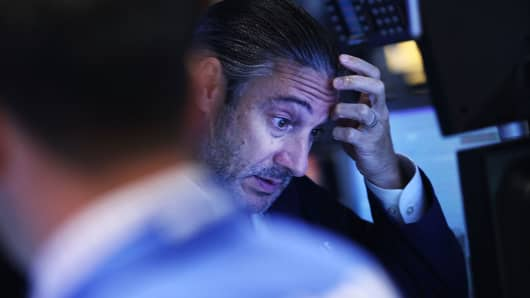 A trader works on the floor of the New York Stock Exchange on August 24, 2015 in New York City.
