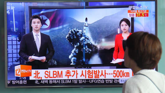 Seoul, August 24, 2016: People watch a TV news program about the Democratic People's Republic of Korea (DPRK) ballistic missile launch. DPRK on Wednesday test-fired a ballistic missile from a submarine off its east coast into the sea at a time of heightened tensions on the Korean Peninsula following the start of annual South Korea-U.S. war games, Seoul's military said.