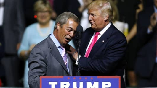 Republican Presidential nominee Donald Trump, right, greets United Kingdom Independence Party leader Nigel Farage during a campaign rally on August 24, 2016 in Jackson, Mississippi.