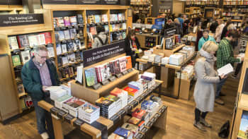 Customers browse books at the newly opened Amazon Books store on November 4, 2015 in Seattle, Washington. The online retailer opened its first brick-and-mortar book store on November 3, 2015.