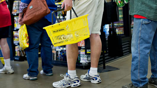 Customers wait to pay for merchandise at a Dollar General store in Creve Coeur, Illinois.