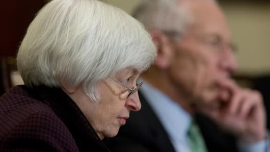 Janet Yellen, chair of the U.S. Federal Reserve, attends an open meeting of the Board of Governors of the Federal Reserve with Stanley Fischer, vice chairman of the U.S. Federal Reserve, right, in Washington, D.C.