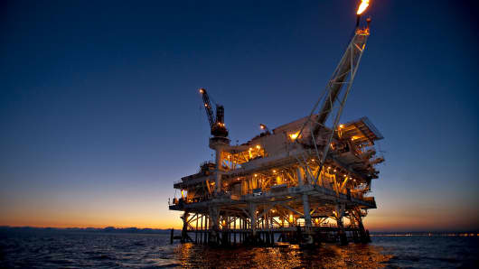 Gas is flared off from a flame boom aboard DCOR LLC's Edith offshore oil and gas platform in the Beta Field off the coast of Long Beach, California.