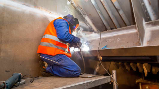 A welder repairs the A1 bridge between Cologne and Leverkusen in Germany.