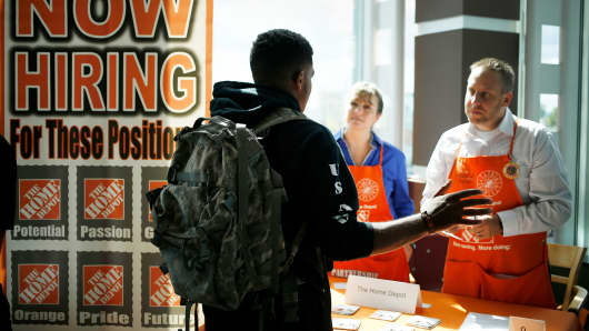 A job seeker speaks with recruiters from The Home Depot at a RecruitMilitary veterans job fair in Cleveland.