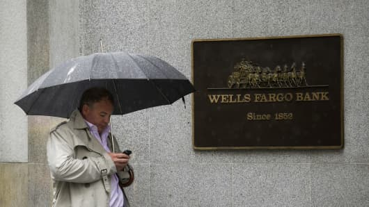 A pedestrian walks in front of Wells Fargo & Co. headquarters in San Francisco, California.