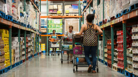 Customers push carts while shopping at a Costco Wholesale store in Hackensack, New Jersey.