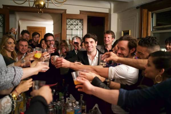 Jon Levy toasting his guests at one of his dinner parties for The Influencers series.
