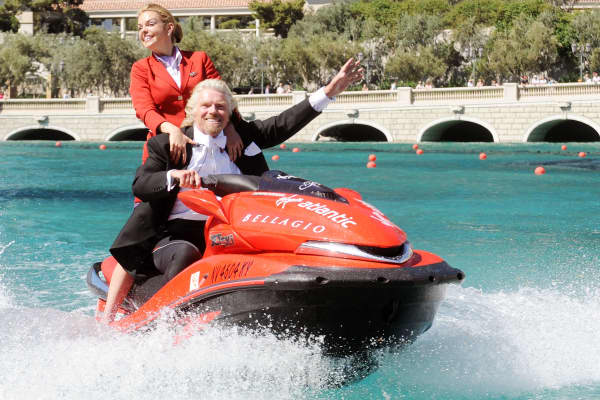 President of Virgin Atlantic Richard Branson and Virgin Airlines cabin attendant Vicky Lewis ride a jet ski in the Bellagio fountains at the Bellagio Hotel and Casino.