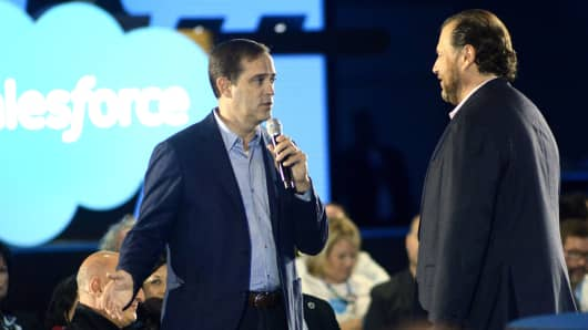 Chuck Robbins, CEO of Cisco Systems (L), and Marc Benioff speak at the Salesforce keynote during Dreamforce 2015 on September 16, 2015, in San Francisco.