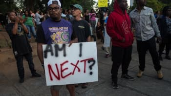 Protesters attend a demonstration against police brutality in Charlotte, North Carolina, on September 21, 2016, following the shooting of Keith Lamont Scott the previous day.