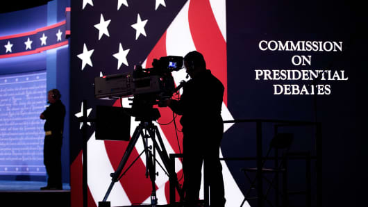 Television news crews prepare for the first presidential debate featuring Democratic presidential candidate Hillary Clinton and Republican presidential candidate Donald Trump at Hofstra University on September 25, 2016, in Hempstead, New York.