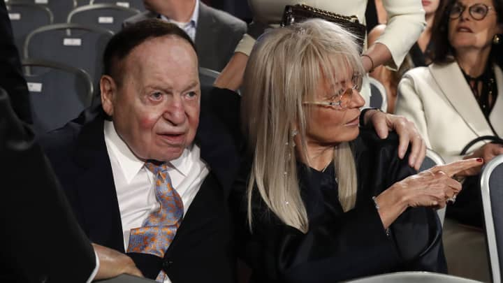 Las Vegas casino magnate Sheldon Adelson sits with his wife Miriam as they await the start of the first debate between Republican U.S. presidential nominee Donald Trump Democratic and U.S. presidential nominee Hillary Clinton at Hofstra University in Hempstead, New York, U.S., September 26, 2016.