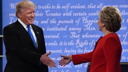 Democratic nominee Hillary Clinton (R) shakes hands with Republican nominee Donald Trump during the first presidential debate at Hofstra University in Hempstead, New York on September 26, 2016.