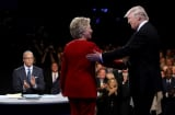 mocratic presidential nominee Hillary Clinton shakes hands with Republican presidential nominee Donald Trump as Moderator Lester Holt looks on during the Presidential Debate at Hofstra University on September 26, 2016 in Hempstead, New York.