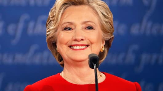Democratic U.S. presidential nominee Hillary Clinton smiles during the first presidential debate with Republican U.S. presidential nominee Donald Trump at Hofstra University in Hempstead, New York, September 26, 2016.
