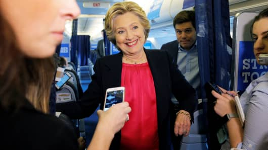 U.S. Democratic presidential candidate Hillary Clinton talks to reporters on her campaign plane in White Plains, New York, September 27, 2016.