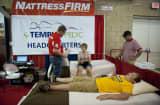 Fairgoers sample mattresses at the Iowa State Fair in Des Moines, Iowa.