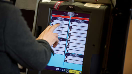 A man casts his electronic ballot at a polling station in Washington, D.C., on November 6, 2012. Fears that cybercriminals will try to interfere in the upcoming election have increased due to recent hacks of the DNC.