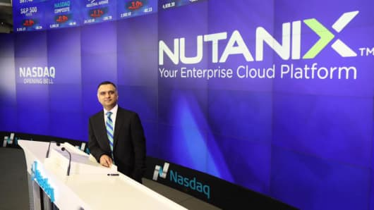 Dheeraj Pandey, CEO of Nutanix, poses at the Nasdaq market site in New York, September 30, 2016.