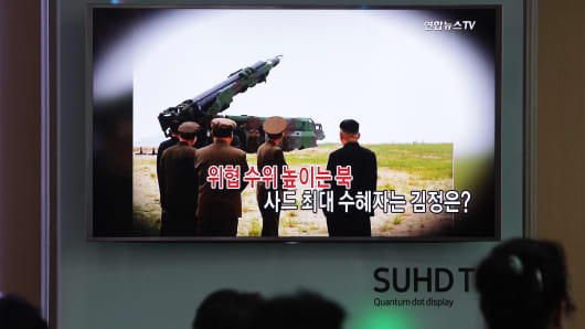 South Koreans watch a television broadcast on July 13 reporting the planned deployment of a Terminal High-Altitude Area Defense missile system in the country.