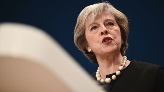 Britain's Prime Minister Theresa May delivers a speech on the first day of the Conservative party annual conference at the International Convention Centre in Birmingham.