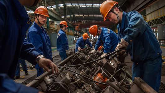 Workers at the Zhong Tian (Zenith) Steel Group factory in Changzhou, Jiangsu.