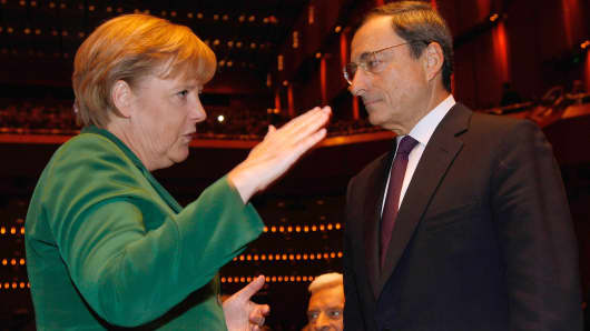 German Chancellor Angela Merkel and Mario Draghi, pictured a month before Draghi took over as president of the European Central Bank in November 2011.
