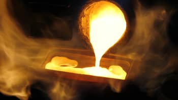 Melted gold flows out of a smelter into a mould of a one kilogram bar at a plant of gold refiner and bar manufacturer Argor-Heraeus SA in the southern Swiss town of Mendrisio.
