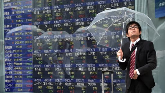 Asian stocks lower on Fed rate hike expectation