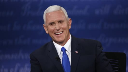 Republican U.S. vice presidential nominee Governor Mike Pence laughs as he discusses an issue with Democratic U.S. vice presidential nominee Senator Tim Kaine (off camera) during their vice presidential debate at Longwood University in Farmville, Virginia, U.S., October 4, 2016.